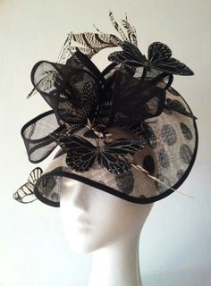 Hat: Black/white polkadot sinamay 'bonnet' with black and white butterfly and tail feather detail http://johannaguerinmilliner.bigcartel.com/product/black-and-white-butterfly-bonnet
