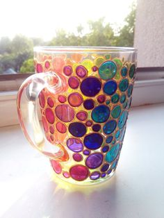 Bubbles Coffee Mug Sun catcher Hand painted Multi Coloured Bubbles Mug Painted Glass mug This is a bright glass coffee mug with hand painted funny bubbles in rainbow colors. When this mug is empty it can be a cute, bright and very positive sun catcher :) It can make unique gift for any occasion or be a great decoration in your house and make drinking coffee/tea more enjoyable :). It can also be a part of beautiful set with other glass pieces with the same design. A great gift for your…