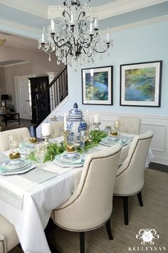 Kelley Nan: Blue and White Easter Table | Easter Table Ideas | Easter Decor | Blue Dining Room with Crystal Chandelier | Restoration Hardware Table | Wreath on mirror