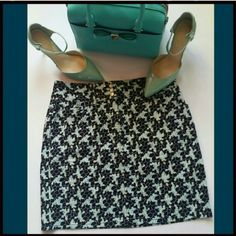 Ann Taylor Stretch Skirt Excellent condition. Worn once. Ann Taylor Loft Stretch skirt. Colors of mint, blue, black. Made of cotton and spandex. Really nice quality with front pockets. Front zipper and pretty triple button details. Great for the office or fun. Ann Taylor Skirts
