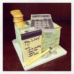 A birthday cake in the shape of stacks of $100 bills for a CPA. His daughter also happens to be getting married the same day. Photo by Sugar Flower Cake Shop. www.sugarflowercakeshop.com
