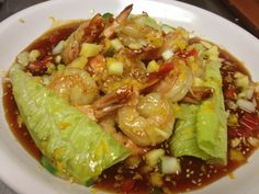 Asian style shrimp over lightly grilled romaine with a citrus sesame sauce