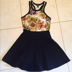 Forever 21 Floral Rassorback Dress This dress hugs your body perfectly! Size medium. 4-6 Top part of dress is cotton, while the bottom is a stretchy black fabric. The dress is in brand new condition. Worn maybe 3 times. Perfect Spring dress! Forever 21 Dresses