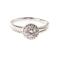 This timeless delight features a round center stone with pave all around!Original Rhodium-plated. #MORANA