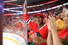 Musician Tom Morello celebrates a #Blackhawks goal at Game 4 of the Stanley Cup Final.