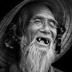 Fisherman, old face, beard, missing teeth, powerful face, intense eyes, wrinckles, lines of life, cracks in time, portrait, photo b/w.