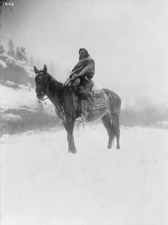 The scout in winter--Apsaroke. Date Created/Published: c1908 July 6. Summary: Apsaroke man on horseback on snow-covered ground, probably in Pryor Mountains, Montana. Photograph by Edward S. Curtis, Curtis (Edward S.) Collection, Library of Congress Prints and Photographs Division Washington, D.C. #