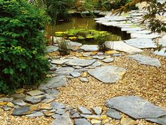 For backyard by firepit. In this garden with a pond, pieces of slate combine with gravel for a natural look.