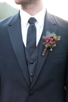 Rustic buttonhole with feathers