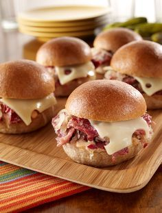Slow Cooker Reuben Sliders are easy, delicious and always a hit at football…