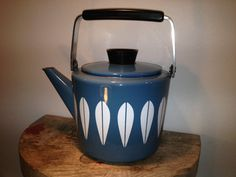Scandinavian design by Cathrineholm of Norway.This enamelware teapot has a white lotus design on a blue background. Brand name : Lotus