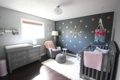 Love this modern, clean design featuring a navy and gold polka dot accent wall - Project Nursery