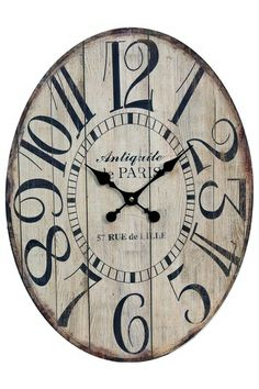 A Natural Wood Plank Oval Clock has a timeless charm that brings your look to life! With a slatted face, this is clock is a shabby chic accessory for your walls!