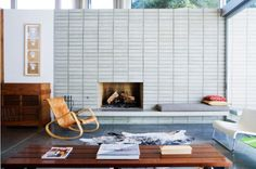 great mid century modern living room with massive brick fireplace w/bench hearth and clerestory windows