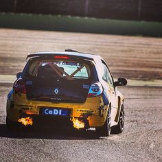 Just your average Renault Clio Cup car three wheelin and spitting flame