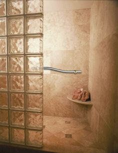 Glass block shower with decorative grab bar and corner seat