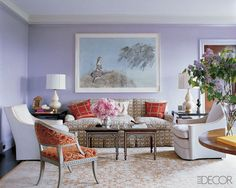 In the living room of a Manhattan apartment decorated by Katie Ridder and renovated by architect Peter Pennoyer, the sofa, armchairs, and Swedish painted chair are upholstered in a C & C Milano linen, J. Robert Scott mohair, and Sahco Hesslein rayon, respectively; the table lamps are by Christopher Spitzmiller, and the colored etching is by Kiki Smith.   - ELLEDecor.com