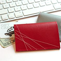 Stitch a vinyl wallet to hold cash or gift cards for dads or grads.