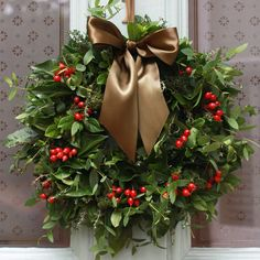 Beautiful Natural Christmas Wreath Composed Of Green Leaves And Red Berries With A Large Brown Ribbon . Outdoor Christmas Wreaths, Christmas Wreaths To Make, Christmas Flowers, Holiday Wreaths, Christmas Diy, Holiday Decor, Green Christmas, Country Christmas, Family Holiday