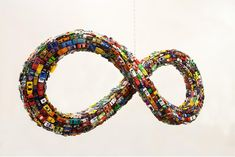 Mobius Beltway, A Mobius Strip Sculpture Covered in Toy Cars via @laughingsquid