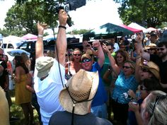 Tambo from No Shoes Radio getting the tailgaters pumped before the Kenny Chesney show in Tampa