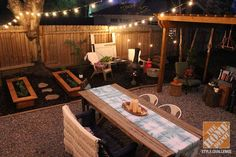 Backyard Makeover: Pergola and patio lit by overhead string lights. We love this gorgeous backyard styled by Lindsay Jackman of White Buffalo Trading Co.    @Lindsay -The White Buffalo Styling Co.