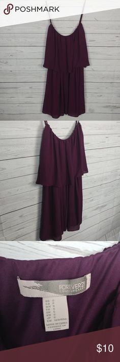 """Forever 21 Plum Tiered Summer Dress Forever 21 Plum Tiered Summer Dress Size S. Cute flowing lightweight dress, perfect for a summer night out.  This item gently used in excellent condition. There are NO observed flaws and is free and clear of anynoticeablestains, rips, tears, or fabric pulls.  Measurements: Bust (underarm to underarm laying flat) 14""""  Thank you for viewing this item and please be sure to check out our closet for more deals! Forever 21 Dresses Mini"""