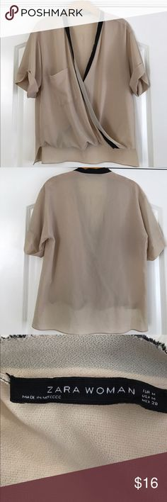 Zara Faux Drape Short Sleeve Blouse Faux wrap draped Blouse. High low hem with slits in the side. Tan fabric with black border. Short sleeves with cuff. Small pocket on chest. Loose fit. Zara Tops Blouses