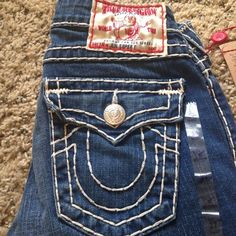 True Religion jeans Brand new True Religion jeans with tags. Size 27. Straight leg. Super cute(: True Religion Jeans