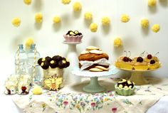Bee Party Dessert Table by neviepiecakes, via Flickr -Also love the pom poms