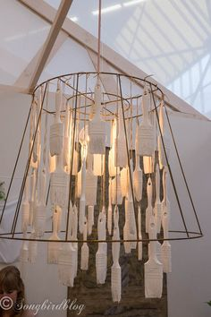 design trend: homemade quirky chandelier. Great idea to dip paint brushes and use them in a chandelier.