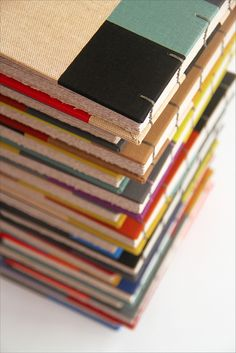 Books inspired by De Stijl from Zoopress. Coptic stitching with linen thread in various colors. via zoopress on flickr