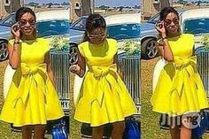 Mini yellow dress ,it comes in other colors.And it came in Lycra Material