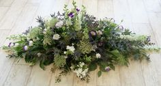 c83c4e944e-funeral flowers-funeral coffin spray purple white thistles (1280x686).jpg (1280×686)