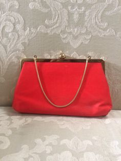 A personal favorite from my Etsy shop https://www.etsy.com/listing/475802300/vintage-satin-clutch-red-clutch-red