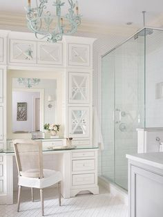 Ivory bathroom boasts walls clad in gray print wallpaper finished with ivory crown moldings and baseboards lined with a tall ivory vanity fitted with mirrored cabinets paired with a French cane back c Casas Na Georgia, Turquoise Chandelier, Arabesque Tile, Georgia Homes, Bathroom Floor Tiles, Bathroom Cabinets, Spring Home, Master Bathroom, White Bathroom