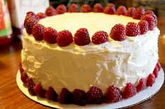 Custom White Chocolate Raspberry cake with raspberry jam filling and fresh raspberry garnish~Diane