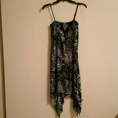 REDUCED SUPER CUTE Mid-maxi dress This cute mid-maxi dress can be dressed up or down. It's got blue, green, black, white, and bursts of gold shimmer throughout! Size Large but fits like a Medium. 95%polyester 5% spandex. NEVER been worn.. EXCELLENT condition! Dresses Maxi