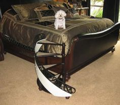Posh spiral staircase for mini pets to get onto the bed