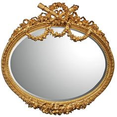Palatial French Mid-19th Century Louis XVI Style Finely Carved Giltwood Mirror | From a unique collection of antique and modern wall mirrors at https://www.1stdibs.com/furniture/mirrors/wall-mirrors/