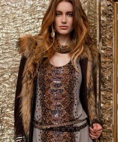 vintage style-hippie chic. Looks good except the fur should be fake.