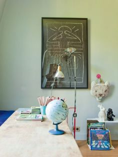 Kids desk area. Globe. Darth Vader toy.