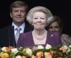 Bittersweet: The new Dutch king and his wife followed Princess Beatrix onto the balcony
