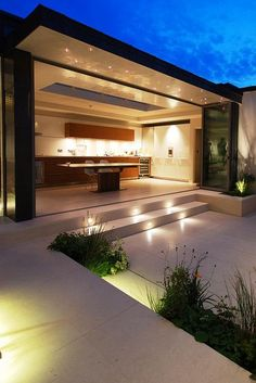 Chelsea Courtyard | Small courtyard with limestone terrace and step lighting | Charlotte Rowe Garden Design