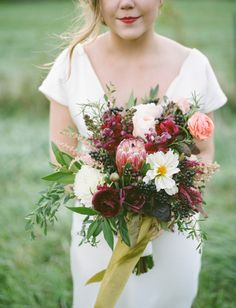 Deep, fall hues: http://www.stylemepretty.com/2015/08/08/25-bouquets-that-will-convince-you-to-blow-your-budget-on-florals/