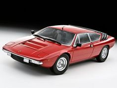 This Lamborghini Urraco P250 Diecast Model Car is Red and features working steering, suspension, wheels and also opening bonnet, boot with engine, doors. It is made by Kyosho and is 1:18 scale (approx. 23cm / 9.1in long). ...