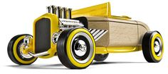 Fire breathing fun! From its eight chrome intake stacks to its bright yellow sidewalls, this bad boy screams for attention. Sure to bring home trophies at the dragstrip or the car show. Interchangeable with other full-size Automoblox models. #Automoblox #CamelotKids #HotRod #WoodenCars
