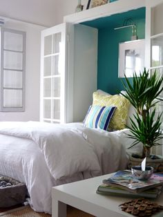 Home Decor Photos: Ocean Inspired Bedroom from The Nest. Great idea. A closet for a headboard.
