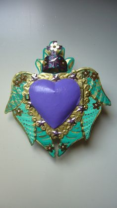 This is part of my new series of nichos Jan 2011!    Absolutely gorgeous Mexican tin nicho painted in purple, turquoise and gold.    This is