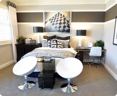 Black, white, & shades of gray.  Striped walls.  Desk & dresser used as bedside tables.